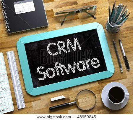 CRM Software. Business Concept Handwritten on Mint Small Chalkboard. Top View Composition with Chalkboard and Office Supplies on Office Desk. Small Chalkboard with CRM Software Concept. 3d Rendering.