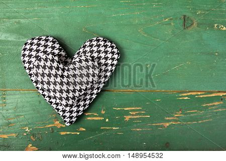 houndstooth hearts on a retro green background