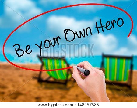 Man Hand Writing  Be Your Own Hero  With Black Marker On Visual Screen