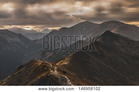 A single man stands on the ridge. The Tatra Mountains