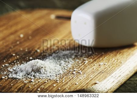 salt heap and shaker on a cutting board horizontal format