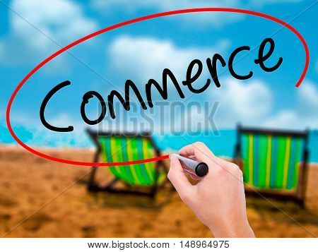 Man Hand Writing Commerce With Black Marker On Visual Screen.