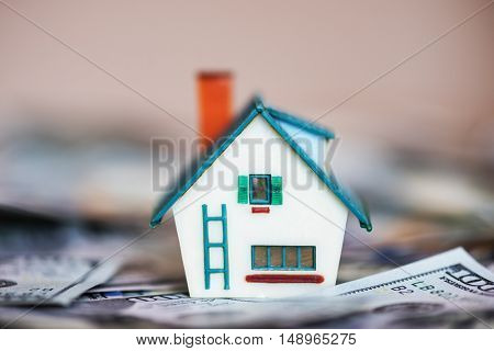 house model on dollar cash stack closeup