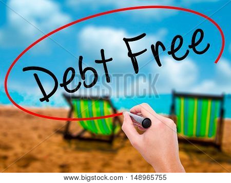 Man Hand Writing Debt Free With Black Marker On Visual Screen