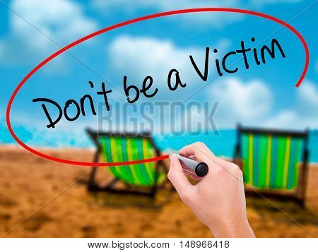Man Hand Writing Don't Be A Victim  With Black Marker On Visual Screen