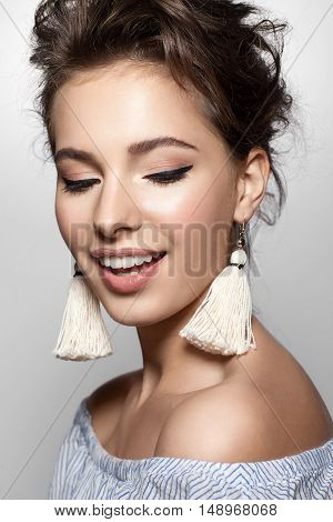 Close-up Face Woman With A Charming Smile In A Summer Dress And Earrings Tassels