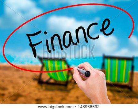 Man Hand Writing Finance With Black Marker On Visual Screen.