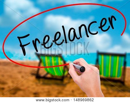 Man Hand Writing Freelancer With Black Marker On Visual Screen.
