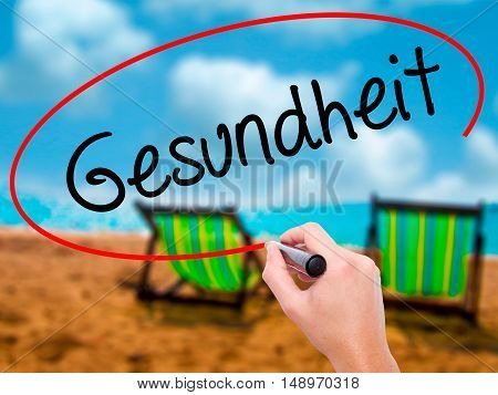 Man Hand Writing Gesundheit (health In German)  With Black Marker On Visual Screen.