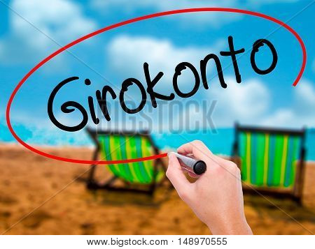Man Hand Writing  Girokonto (checking Account) With Black Marker On Visual Screen