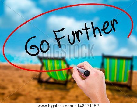 Man Hand Writing Go Further With Black Marker On Visual Screen