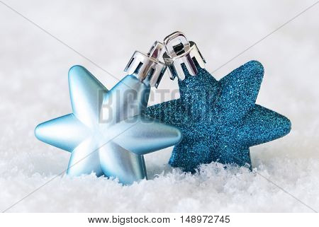 Dark And Light Blue Christmas Tree Balls With Star Shape. Macro Or Close Up View. Christmas Decoration Or Ornament On Snow. Christmas Greeting Card For Seasons Greetings
