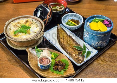 Luxurious Japanese meal set - broiled sole fish and boiled loaches with egg and burdock poster