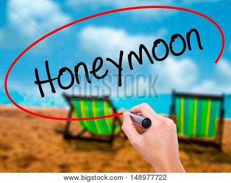 Man Hand Writing  Honeymoon  With Black Marker On Visual Screen
