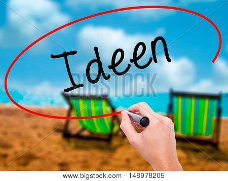 Man Hand Writing Ideen (ideas In German)  With Black Marker On Visual Screen