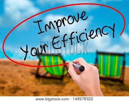 Man Hand Writing Improve Your Efficiency With Black Marker On Visual Screen