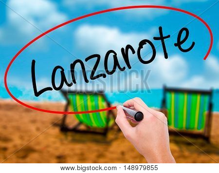 Man Hand Writing Lanzarote With Black Marker On Visual Screen.