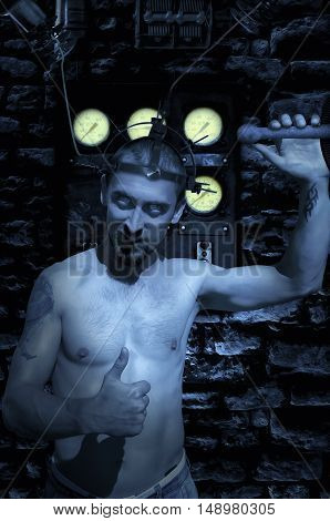 Madman trying electricity on itself. Horror concept.