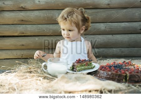 Little Boy Eats Fruit Cake