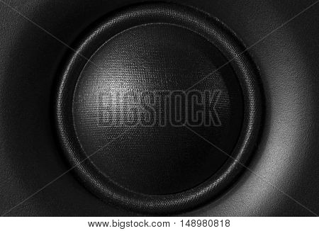 Black and white frontal image of a high-frequency audio speaker.