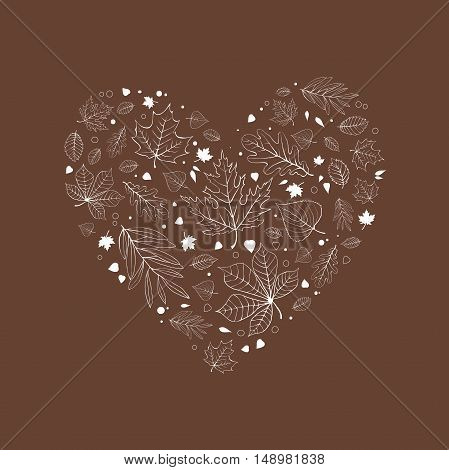 Autumn leaves heart design white outline on brown background