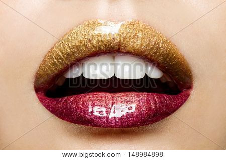 Beautiful female lips with a gradient coloring from gold to red