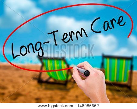 Man Hand Writing Long-term Care With Black Marker On Visual Screen