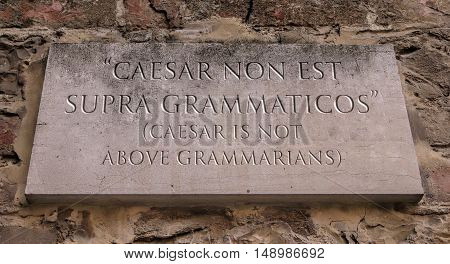 Caesar non est supra grammaticos. Latin phrase, usually translated into English as Caesar is not above grammarians, meaning that grammar comes before power. Engraved text.