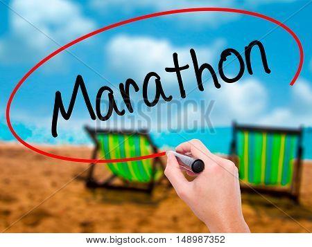 Man Hand Writing Marathon With Black Marker On Visual Screen.