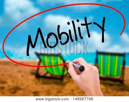 Man Hand Writing Mobility With Black Marker On Visual Screen