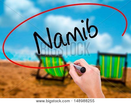 Man Hand Writing Namib  With Black Marker On Visual Screen