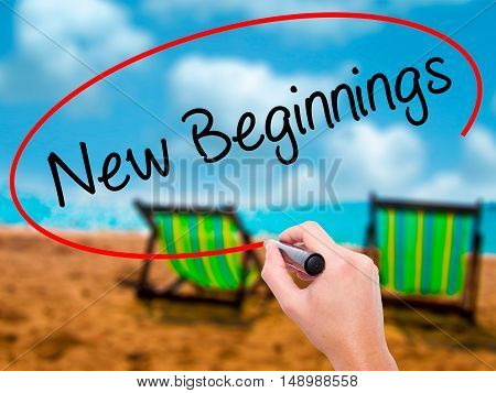 Man Hand Writing New Beginnings With Black Marker On Visual Screen