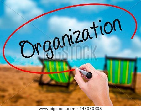 Man Hand Writing Organization  With Black Marker On Visual Screen.