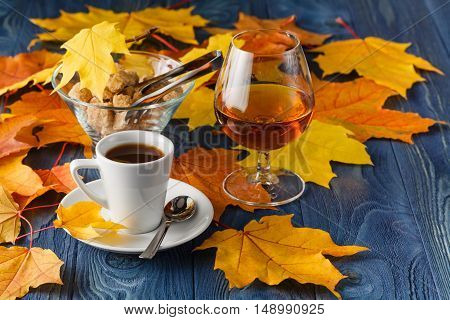 set of coffee and cognac on fall background