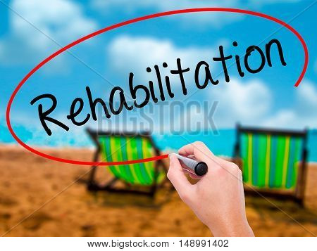 Man Hand Writing Rehabilitation With Black Marker On Visual Screen