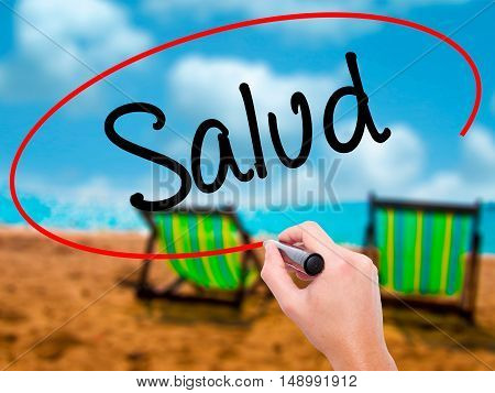 Man Hand Writing Salud (health In Spanish) With Black Marker On Visual Screen.
