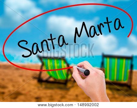 Man Hand Writing Santa Marta With Black Marker On Visual Screen