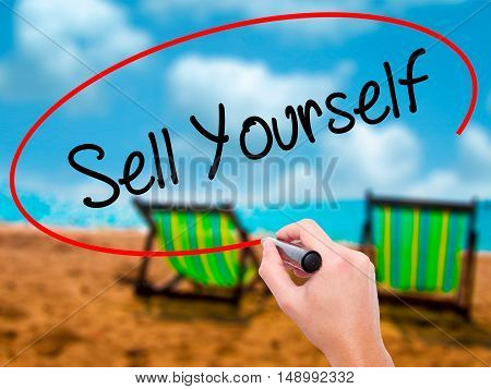 Man Hand Writing Sell Yourself With Black Marker On Visual Screen
