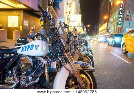 NEW YORK - CIRCA MARCH, 2016: police motorcycles of the New York Police Department at night. NYPD is the largest municipal police force in the United States.