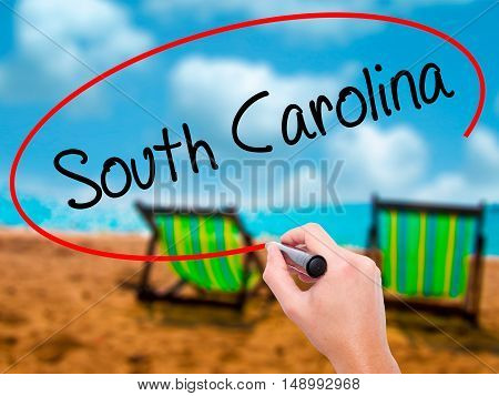 Man Hand Writing South Carolina With Black Marker On Visual Screen.