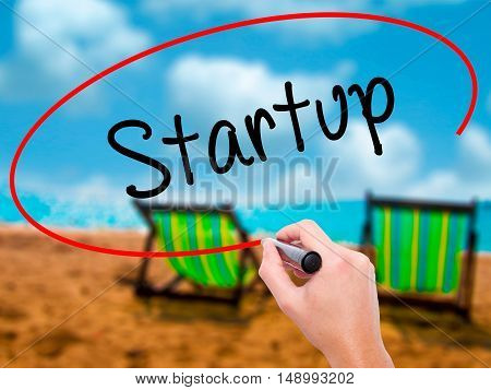 Man Hand Writing Startup  With Black Marker On Visual Screen