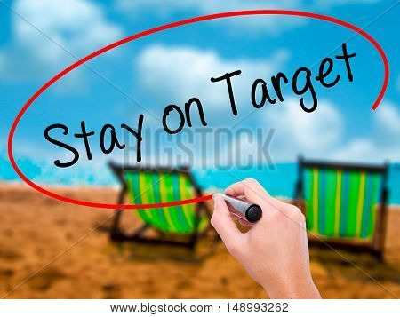 Man Hand Writing Stay On Target With Black Marker On Visual Screen.