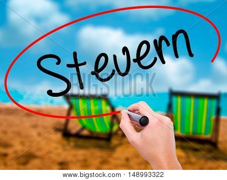 Man Hand Writing Steuern (german Tax) With Black Marker On Visual Screen