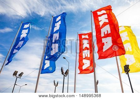 SAMARA RUSSIA - SEPTEMBER 25 2016: IKEA flags against a blue sky near the IKEA Samara Store. IKEA is the world's largest furniture retailer. It was founded in Sweden in 1943
