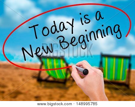 Man Hand Writing Today Is A New Beginning With Black Marker On Visual Screen