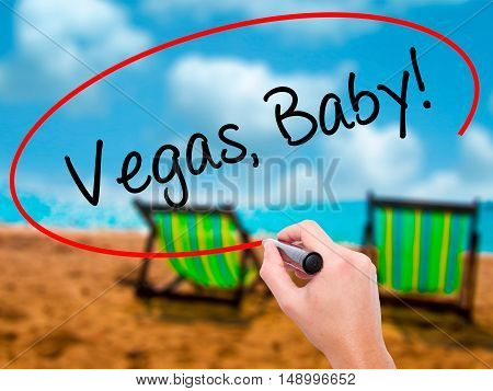 Man Hand Writing  Vegas, Baby!  With Black Marker On Visual Screen