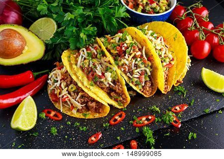 Mexican food - delicious taco shells with ground beef and home made salsa.