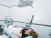 Caucasian woman patient awaiting laser skin resurfacing. Laser in aesthetic medicine. poster