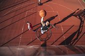 Basketball player scoring a slam dunk on the court. poster