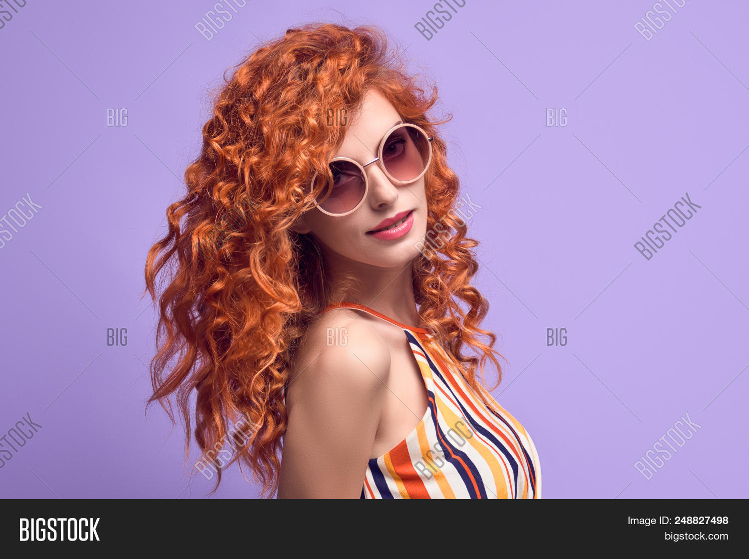 d648658ae63e Portrait Young Redhead Girl Smiling in Studio on Purple. Beautiful woman in  Stylish Summer Outfit